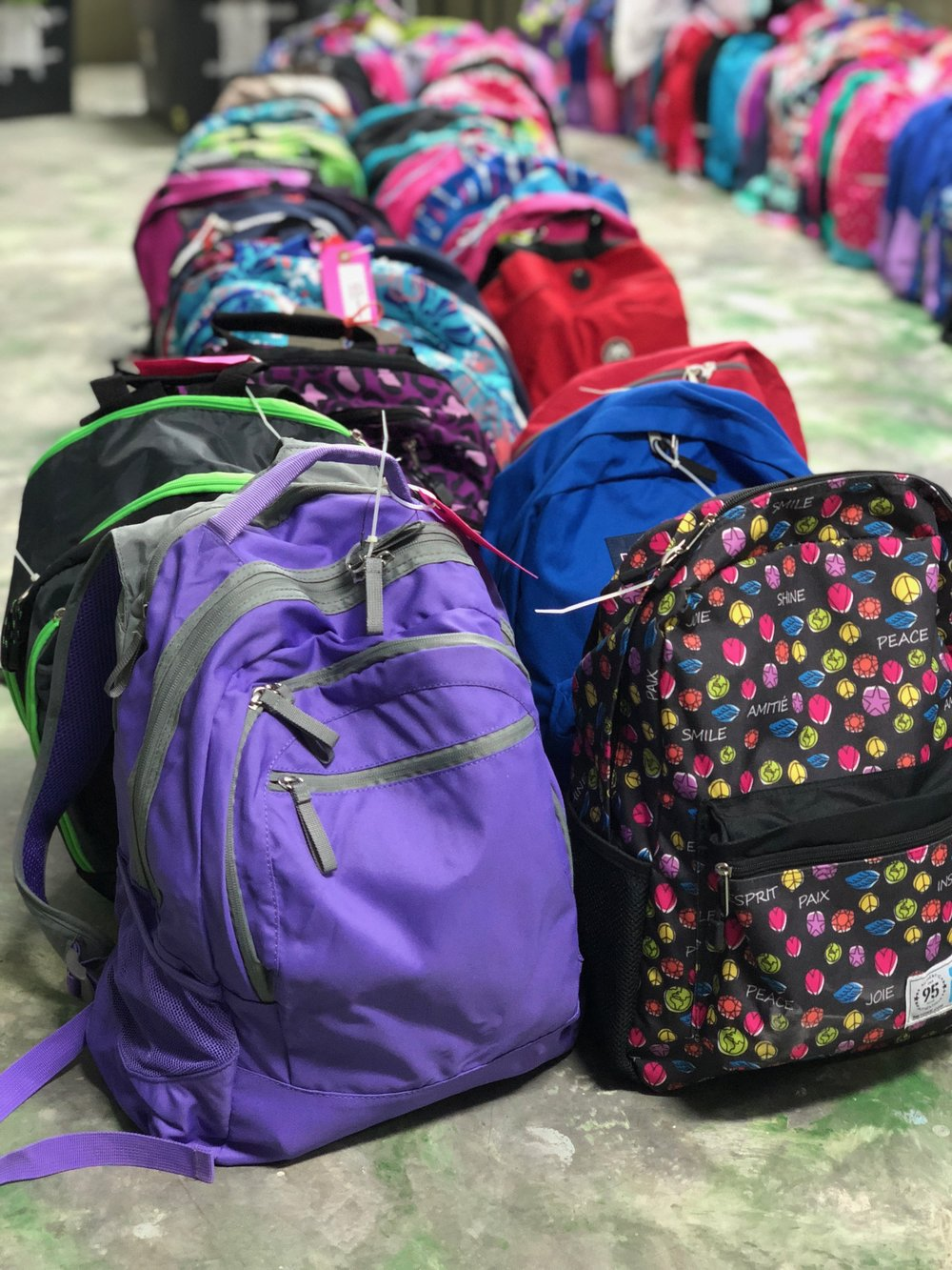 Send a Backpack - We pack and ship over 300-320 backpacks each year to Haiti, Each is made specifically for the needs of each sponsored child to attend school.