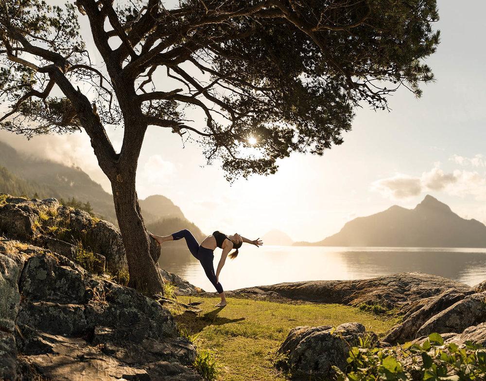Women-doing-yoga-backbend-with-sun-near-water_g.jpg