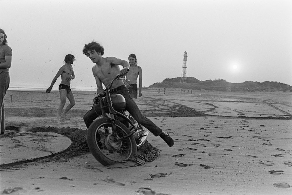 Lads on motorbike on beach. Documentary photograph by Roger Deakins for the Beaford Archive © Beaford Arts