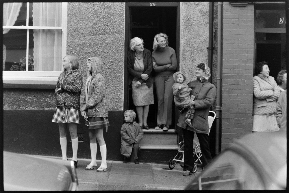 Carnival.  Women at the front door. Bideford, September 1973