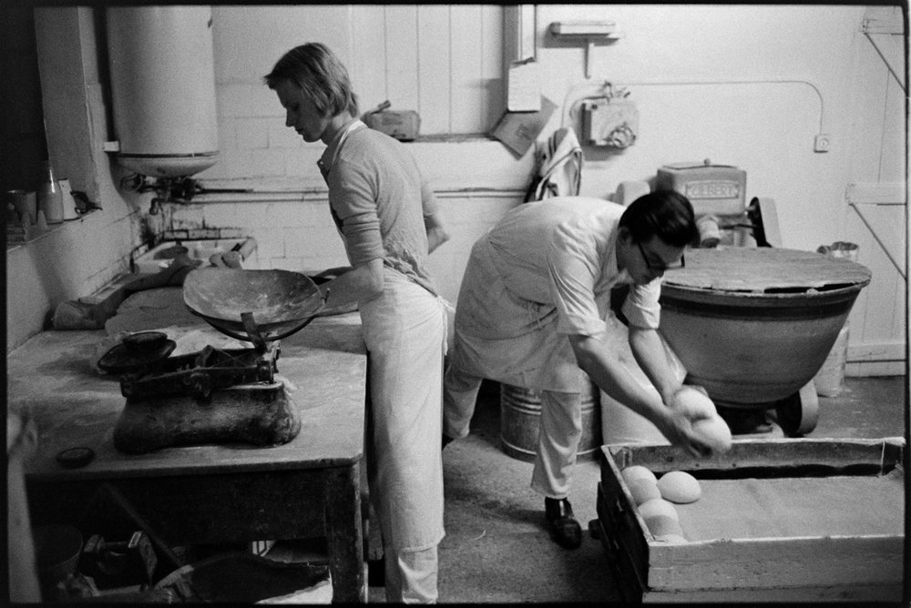 Baker with fresh loaves, very early in the morning, Winkleigh, 15 November 1974