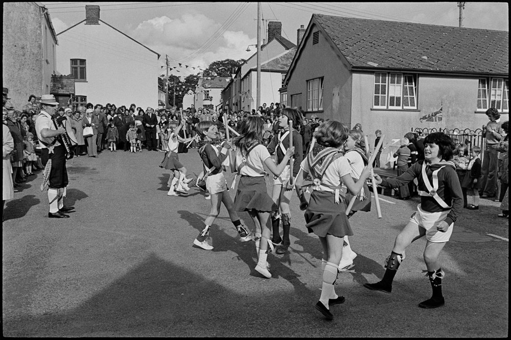 Children Morris dancing in village street, High Bickington,  6 June 1977