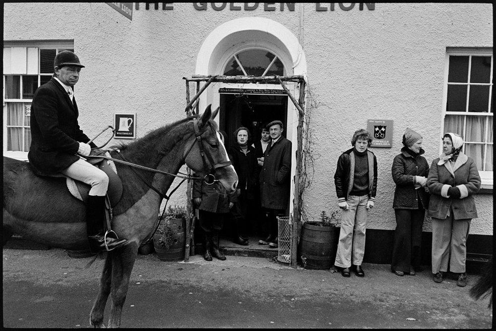 Hunt meet with spectators outside Golden Lion pub, High Bickington, Dec 1977