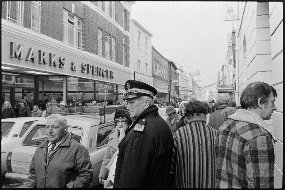Human Landscape. Street scene, shoppers, traffic warden, M&SBarnstaple, Dec 1979