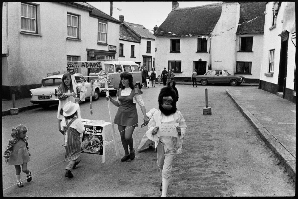 Fancy dress - ape and T. Adams butcher, Winkleigh, 20 July 1974