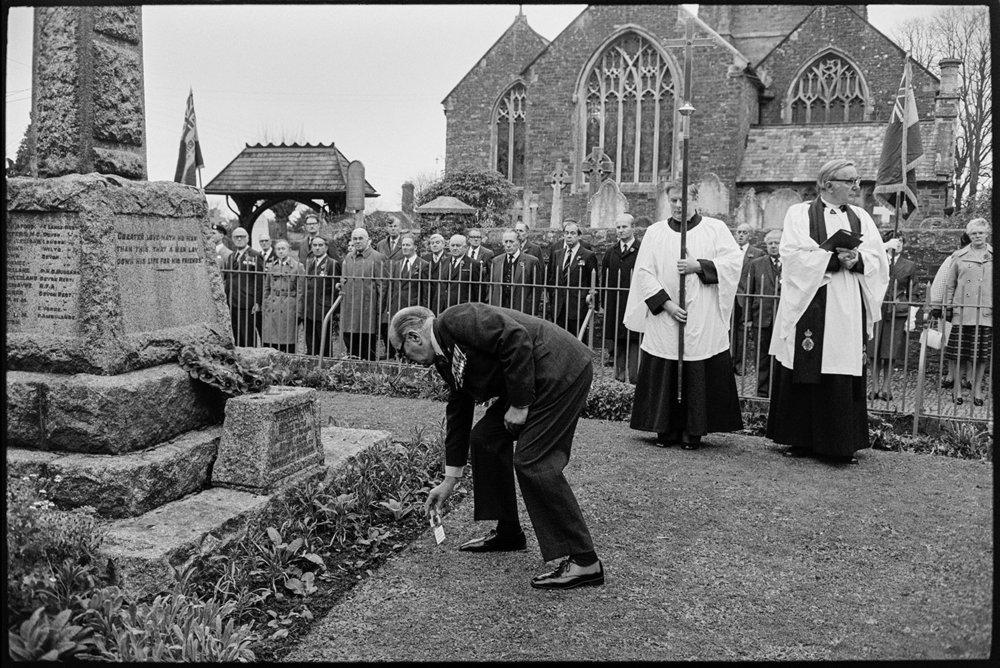 Armistice Day, man laying poppies.  Chulmleigh, November 1981