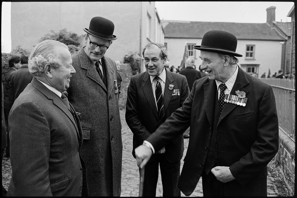 Armistice Day, men chatting after parade, officers in bowler hats.  Chulmleigh, November 1981.