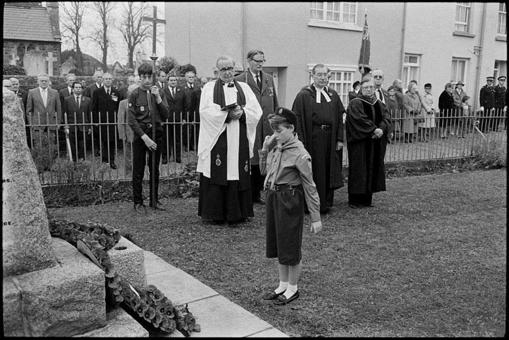 Parade at Memorial, laying wreath by girl guide.  Chulmleigh, November 1987.