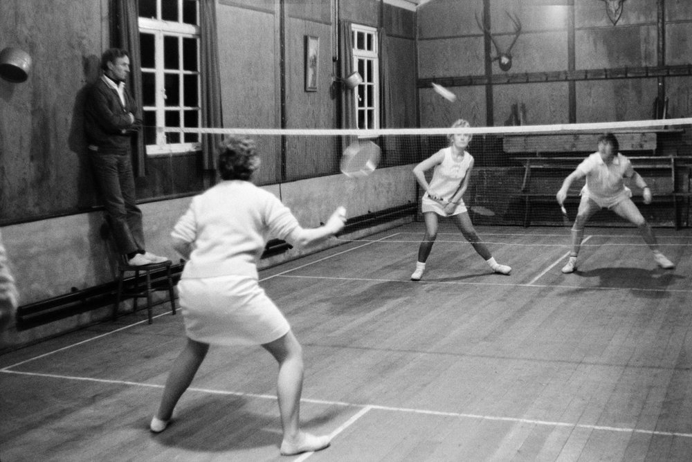 People playing badminton, 9 December 1971. Documentary photograph by Roger Deakins for the Beaford Archive.