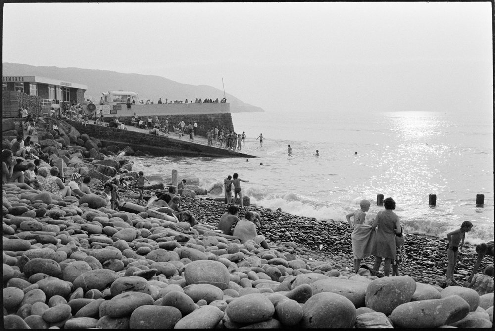 People on beach, Westward Ho! August 1973. Documentary photograph by James Ravilious for the Beaford Archive © Beaford Arts