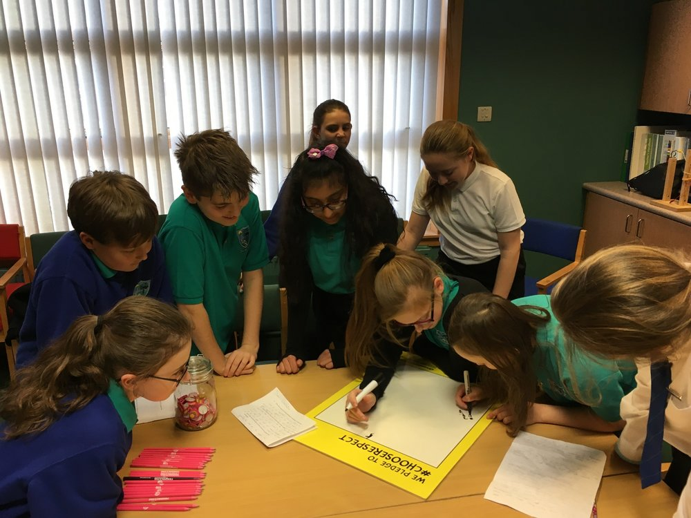 Pupils from Lawthorn Primary School sign the pledge.jpeg