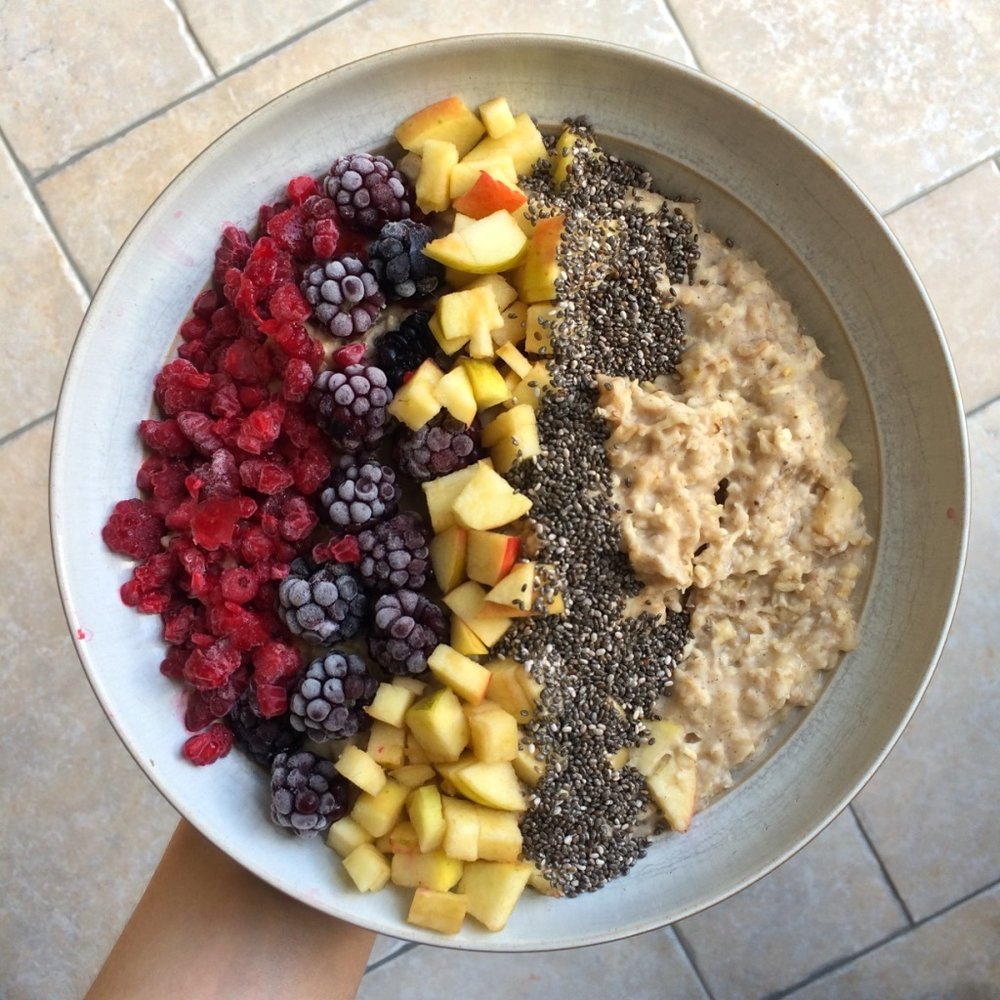 Home-grown apple oatmeal with frozen berries, more diced apple and a very generous sprinkling of chia seeds.