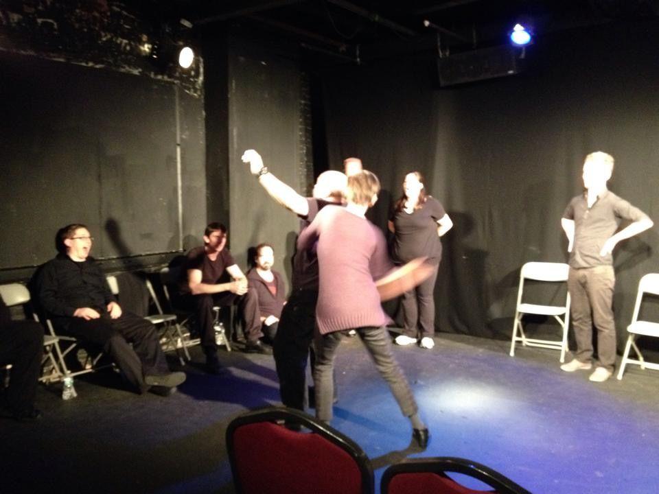 Blanka Zizka spanking Benjamin Lloyd onstage at IMPROVATHON 2014