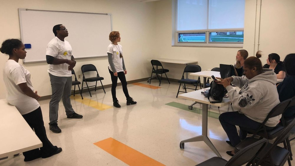 Ensemble members Kiersten Adams and Eric Walker observe CCT facilitator Leah Holleran at a workshop for the West Philly Skills Initiative.