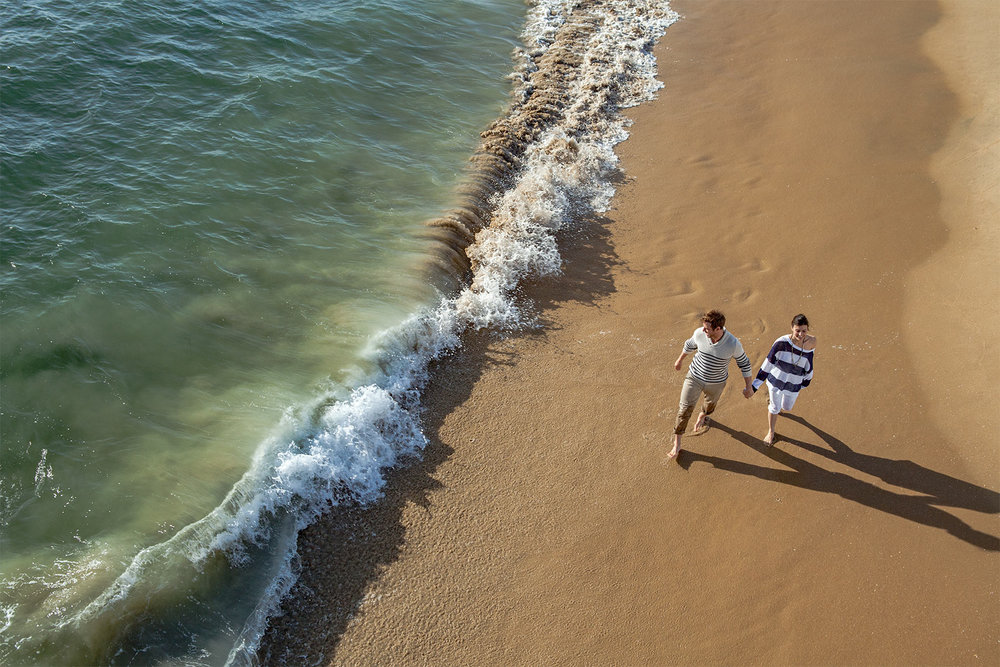 COUPLE.WALKING.BEACH.jpg