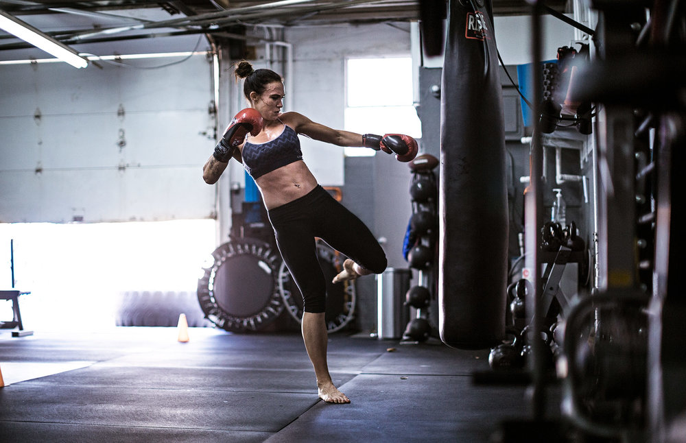 Lacie practicing her low kicks on a heavy bag.