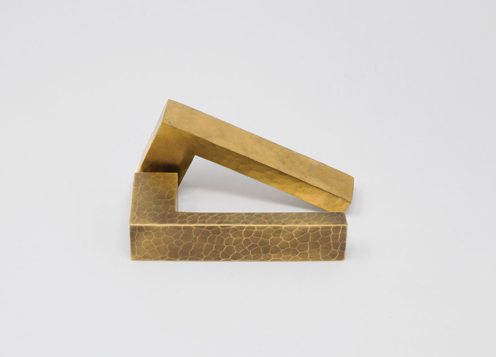 HL043 - The simple, right angle shape of this lever lends itself to the modern aesthetic. When embellished with hammering or texturing, it enters a new visual dimension.