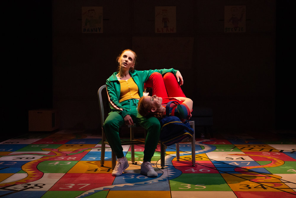 """Ruby Wolf as Marnie and Rachel Brodeur as Autumn in Inis Nua Theatre's """"Box Clever"""" by Monsay Whitney. Photo Credit: Plate 3 Photography"""