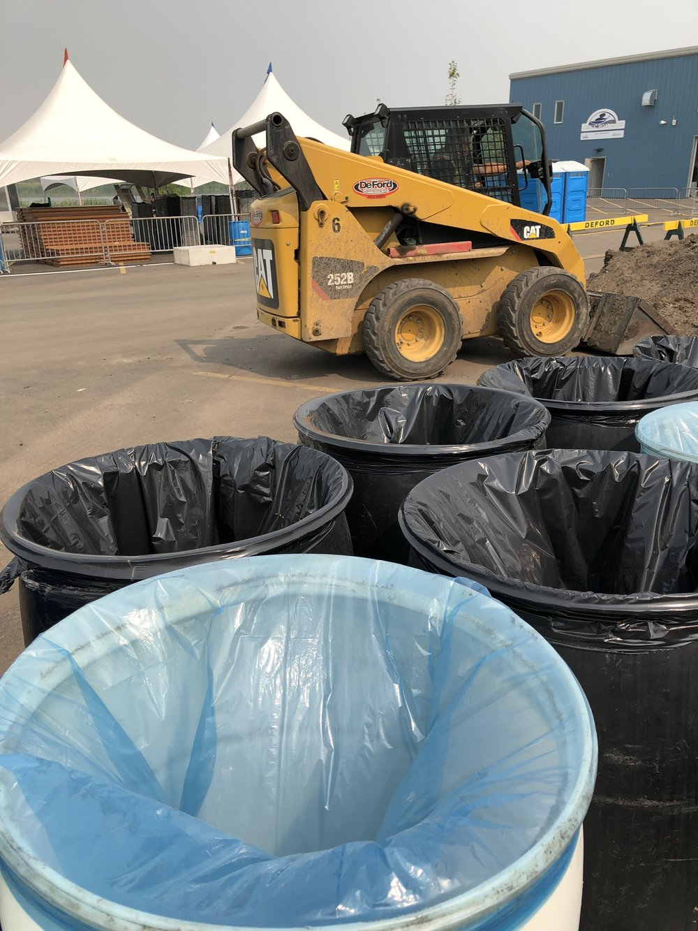 """Thursday afternoon: a big pile of dirt right where the merchandise tent is supposed to be. We wanted to put up a tent and call it a """"sandbox"""" but ... liabilities."""