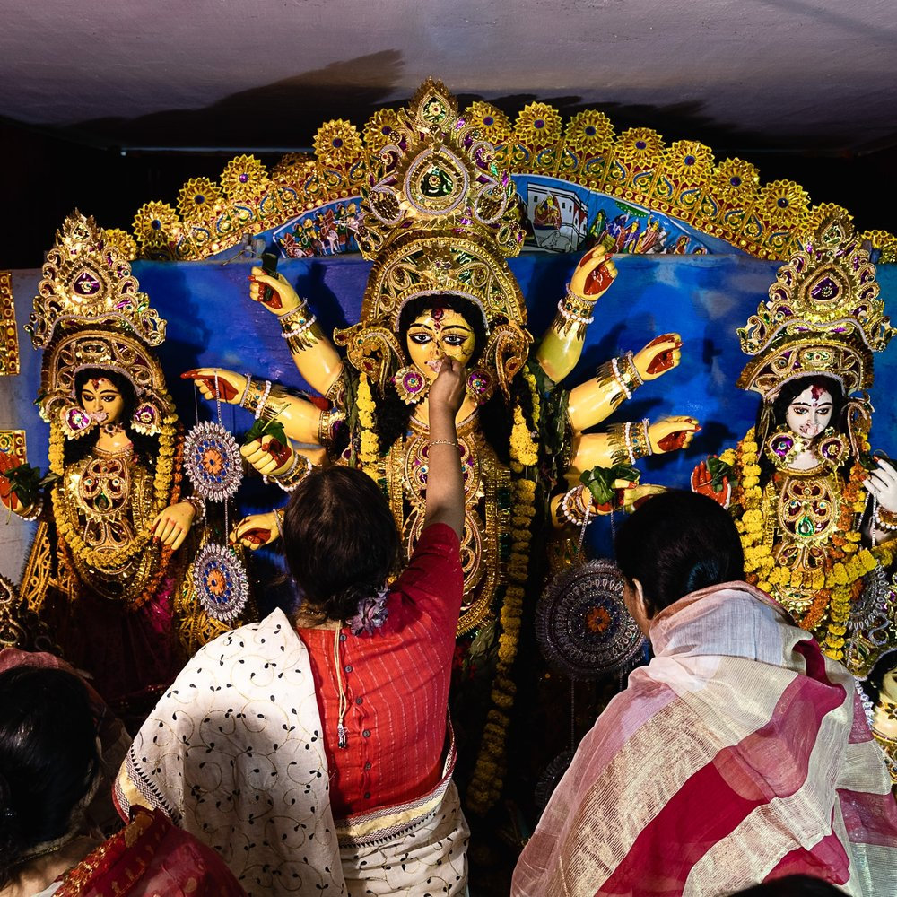 Visarjan - All good things must come to an end. It is time to bid the goddess goodbye (and wish her happy journey). Asche bochor abar hobe - she will be back next year.