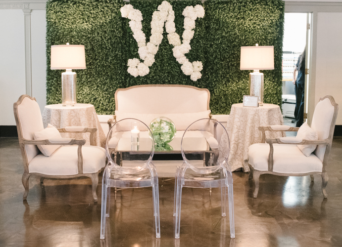 hedge wall, ghost chair, lamps, love seat