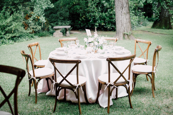 pink linen, outdoor dining, wood chair with x, crossback chair