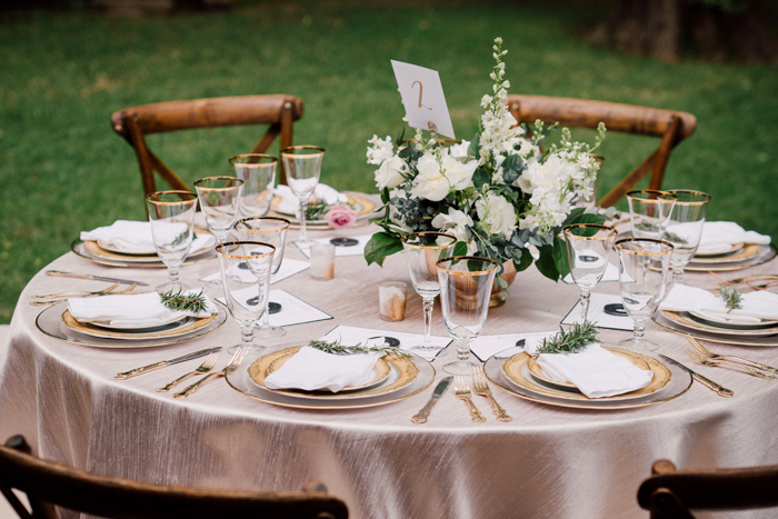 table with pink linen, x back chair, cross back chair, table setting