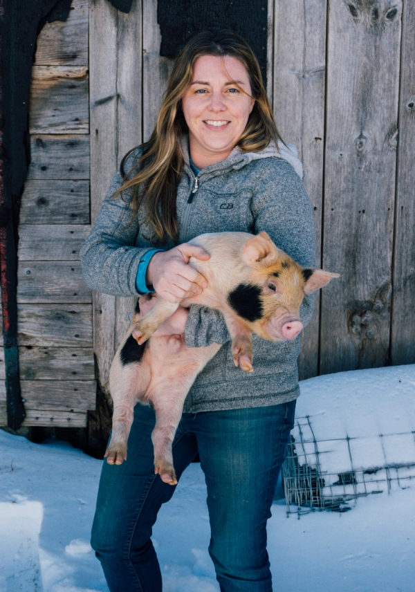 Kate with one of her heritage piglets.