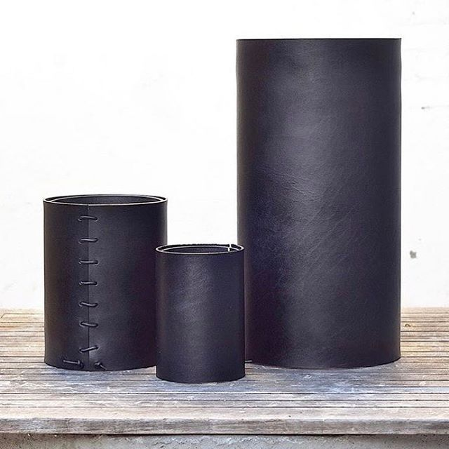 Sleek ➕ unique | bison-wrapped vases add allure to any space. Find these beauties from @madesolidinla in Black Bough today.