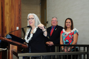 MEDB Vice President Leslie Wilkins (at podium) thanked Maui Council Members for their support of MEDB and STEM education. Pictured with Councilmember Don Couch and MEDB's Mapu Quitazol.