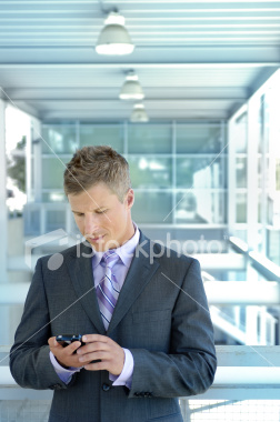 istockphoto_4170668-businessman-on-mobile-device.jpg