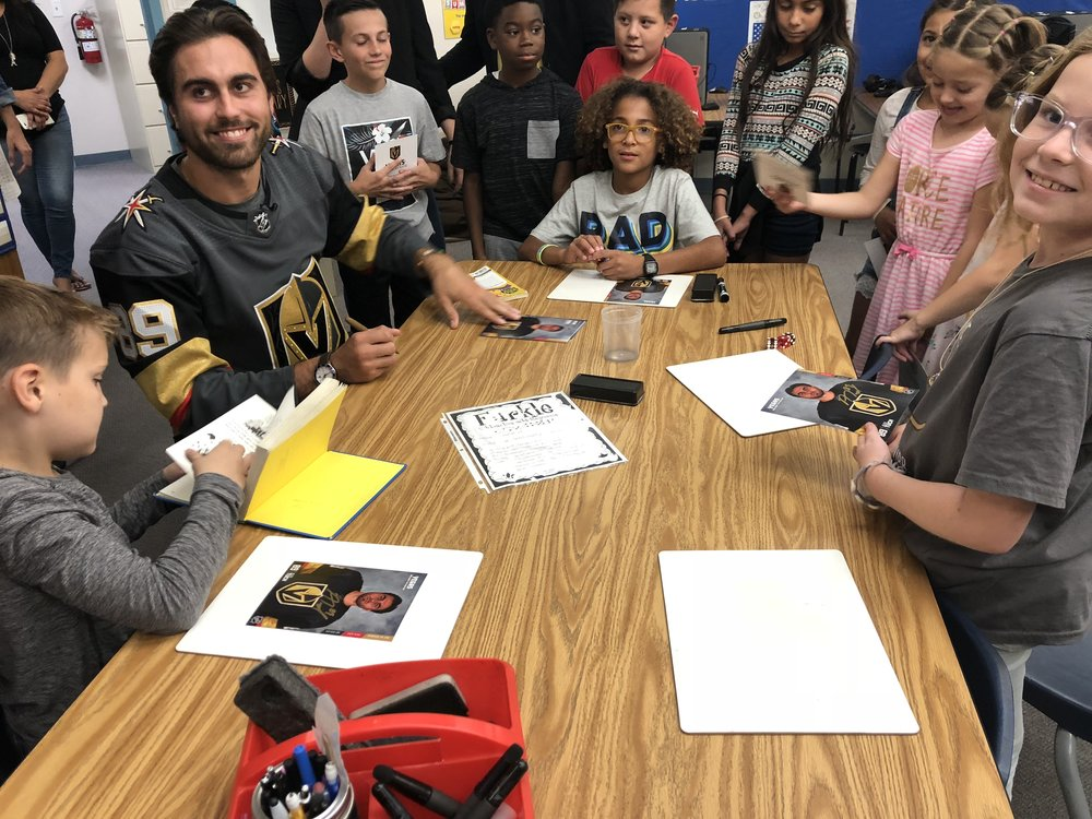 Alex Tuch nothing but smiles for autographs with the students.