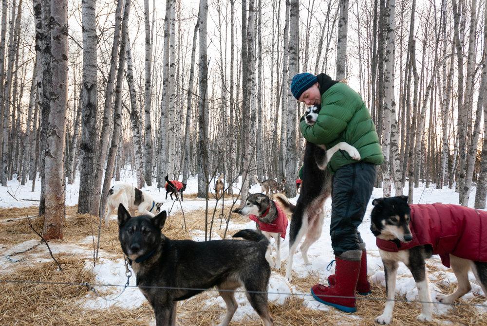 Sigrid gets a hug from Puck, her goofiest dog. Knik, Alaska. February 2007.