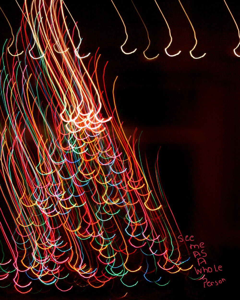 These photographs were created at night using a slow shutter speed and colored lights. Afterward, I looked at each abstract image and felt that they described how I, as a differently abled person, feel sometimes. The darkness that surrounds the light paintings merely acts to show the beauty of the colors and shapes. These photographs represent the positivity of being differently abled and the hope that the world would accept me as I am.  Title: See Me AS I Really Am  Medium: Photography/Digital Arts  Size: 8 x 10  Price $200  For sales inquires, please contact the artist directly at  www.laurenmosco.com