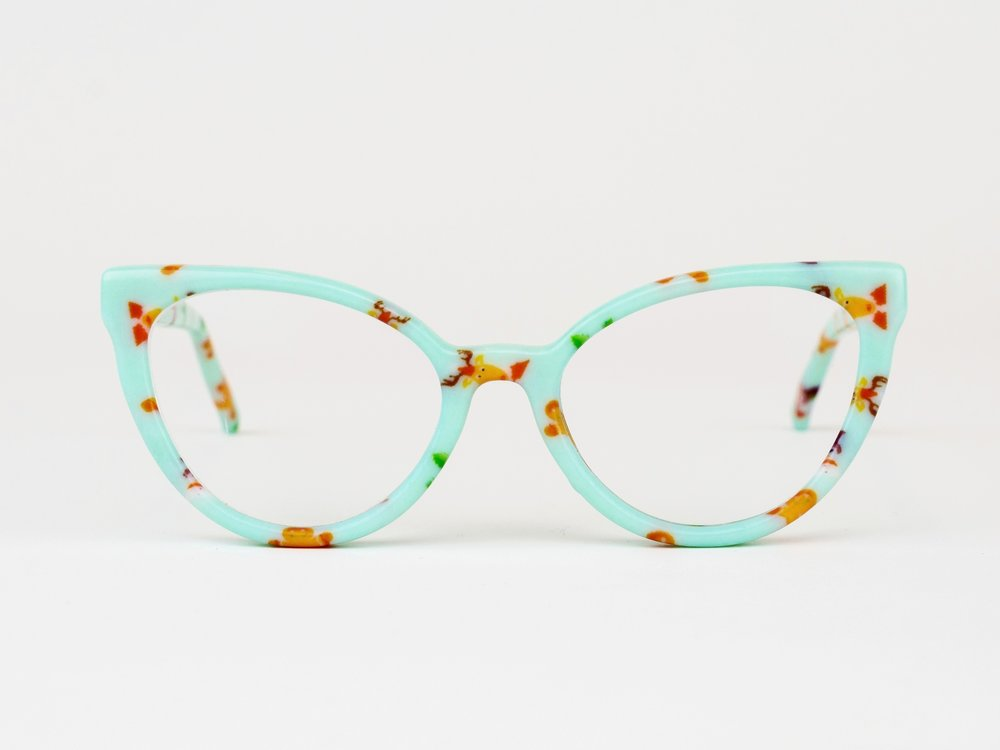 Swan - For those who blaze their own path. The Swan is a striking cat eye frame inspired by trailblazing astronomer Henrietta Swan.Available in any color or pattern that your heart desires.
