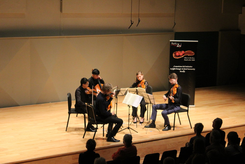 Versoi Ensemble musicians performing in concert benefitting local food bank in Sarasota, FL. (Photo: Cecilia Yao)