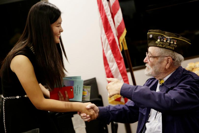 Audrey Li meeting with a U.S. veteran.