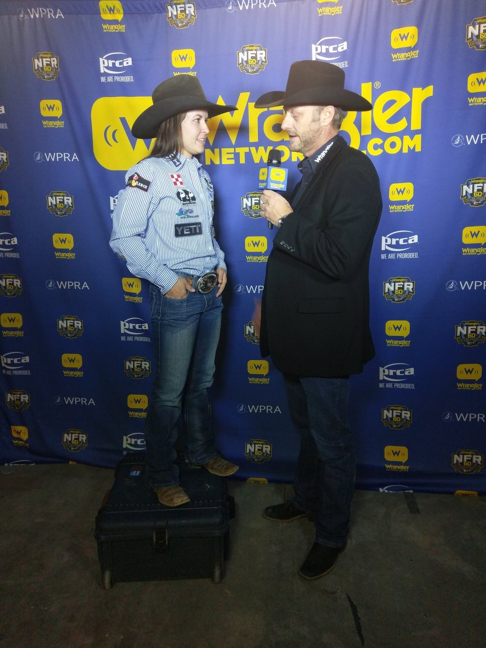 Hailey standing on something while being interviewed at the 2018 WNFR because she's a tiny human. So cute though…