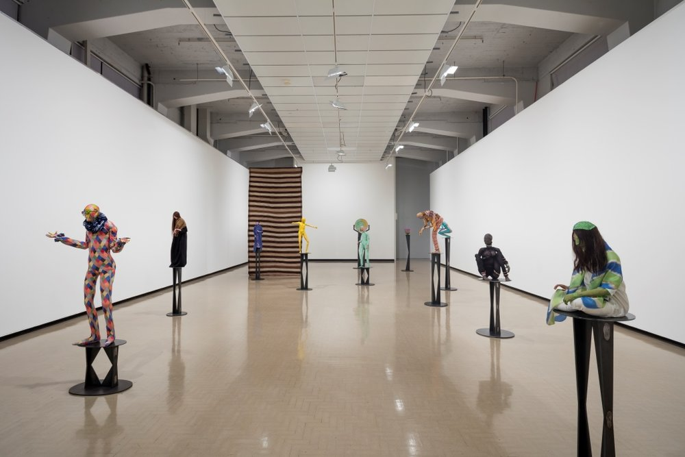 Francis Upritchard: Jealous Saboteurs  installation view at City Gallery Wellington, 2016. Photo: Shaun Waugh. This image features  Tourist  and  Jockey  (2012) and  Hannah  (2016) including stands by Martino Gamper. Image courtesy of City Gallery Wellington.