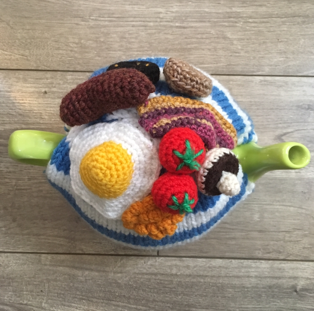 The full Irish tea cosy, featuring a fried egg, becon, saussage, mushrooms and tomatoes.png