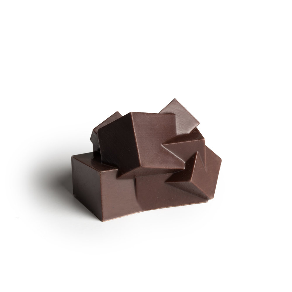 Spicy mountain pepperberry & dark chocolate   Rich and creamy dark chocolate complemented by the peppery spiciness of this forest berry from Southern regions of Australia.