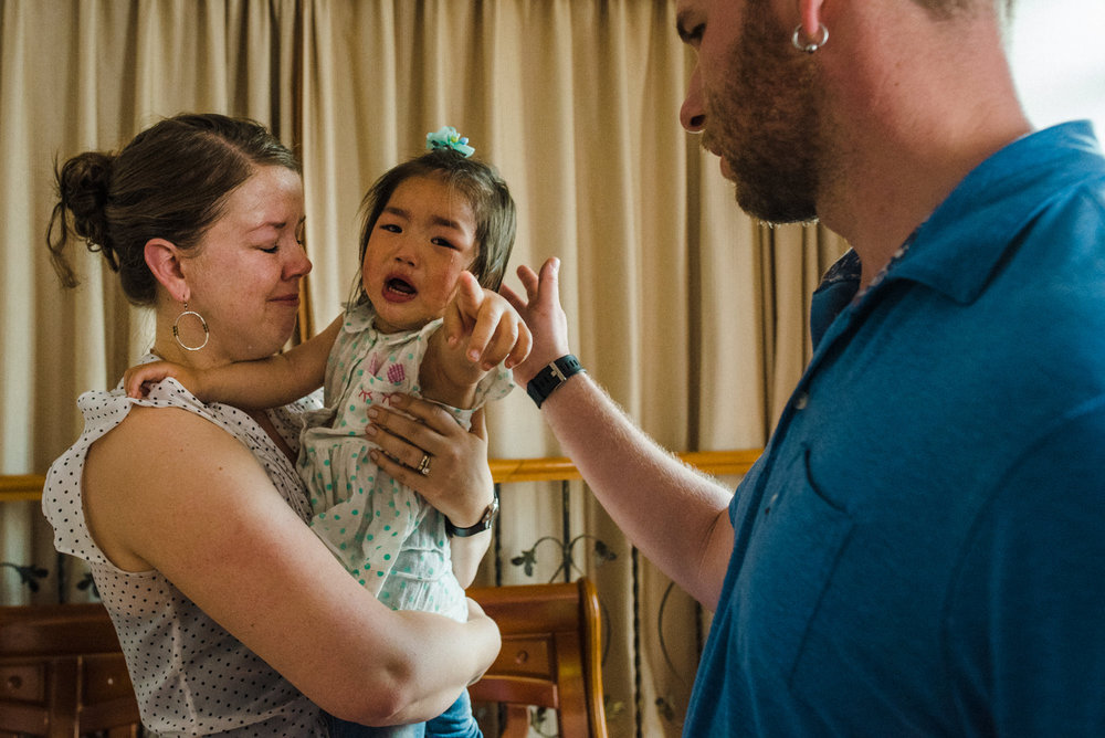 Victoria, in Signe's arms, cries out as her foster mother leaves her with her new parents. Victoria lived for a year in her foster mother's care.