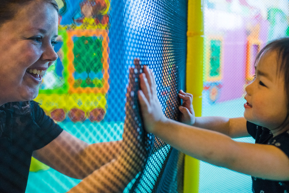 Victoria and Signe enjoy the play area of an indoor gym at their hotel.