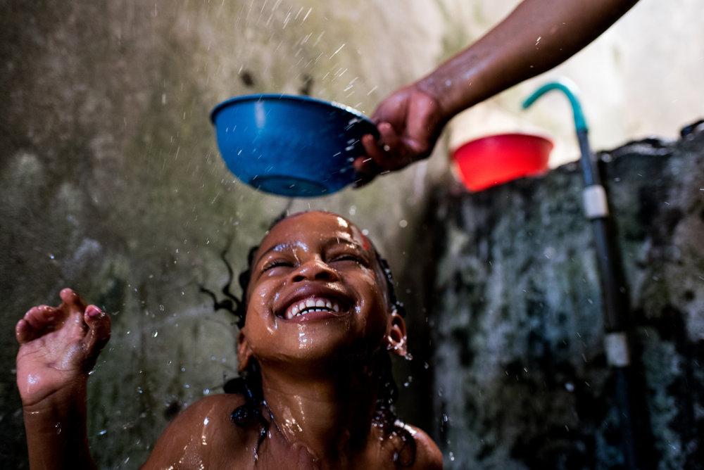Ebony enjoys a bath in her home in Buenaventura.