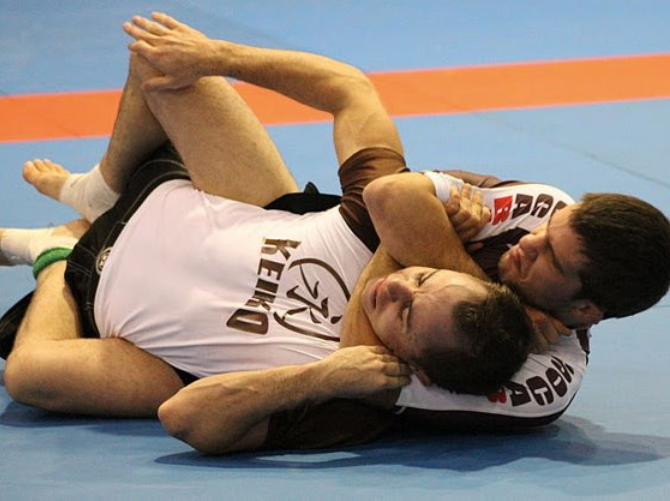 Note the attackers use of hooks (legs) to create extension in the opponent, removing frontal/transverse movement options and making the position much harder to defend