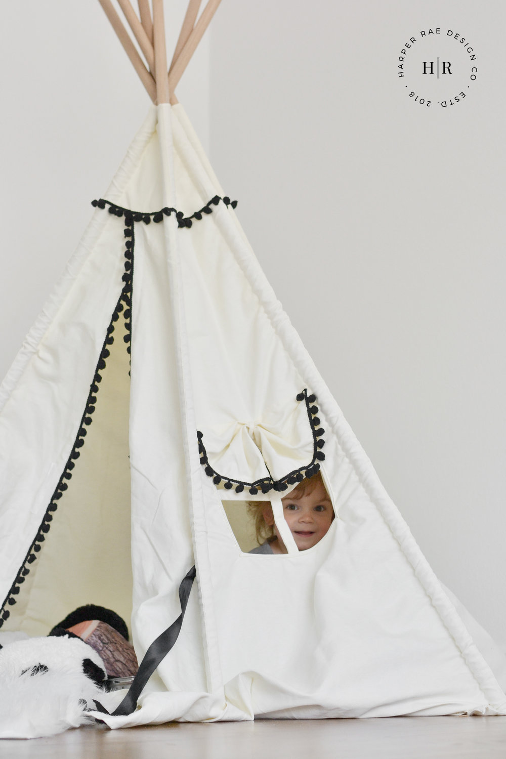 zoe inside teepee with logo.jpg