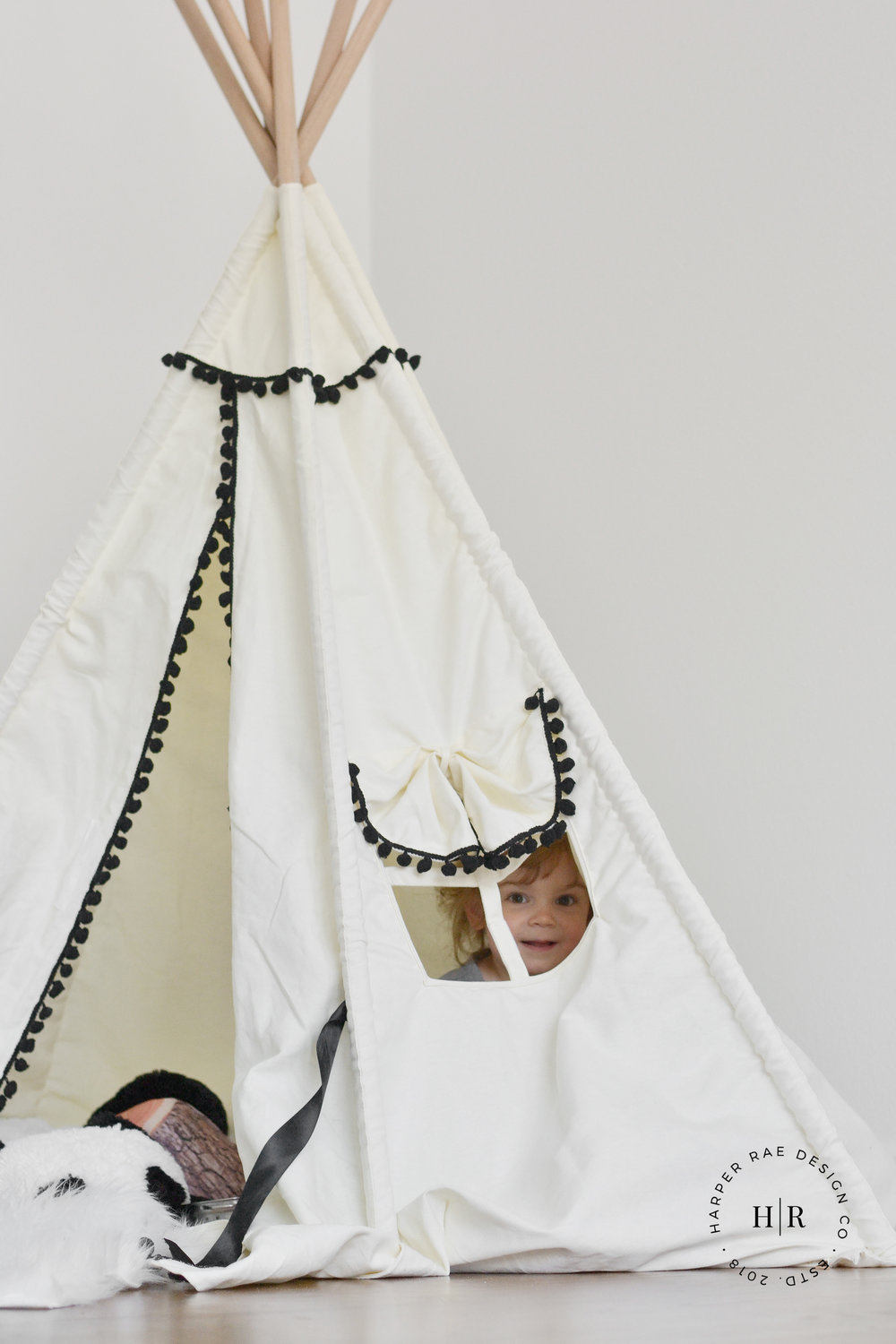 zoe inside teepee with bottom logo.jpg
