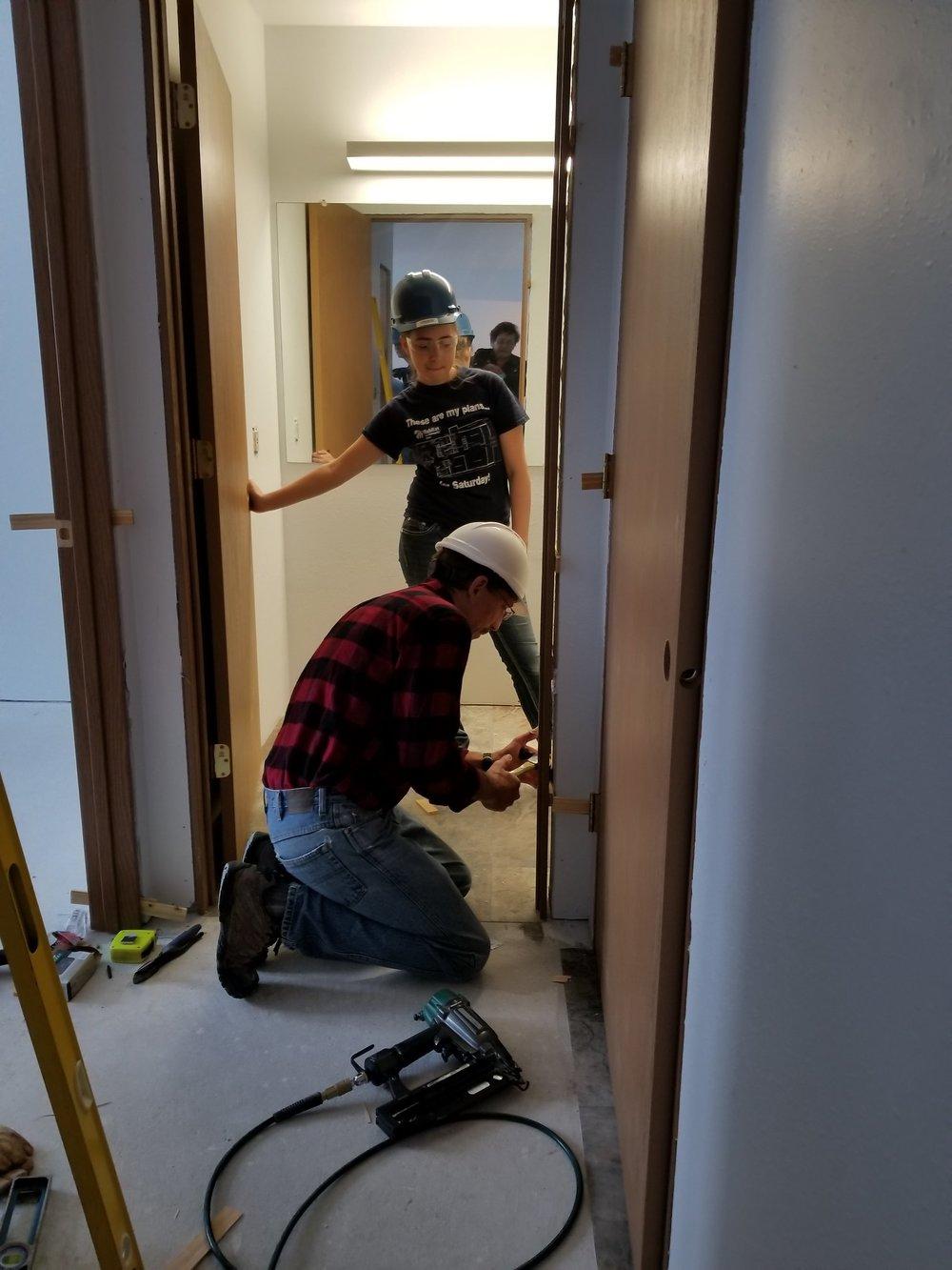La Valle - UWM student with Jim hanging door.jpg