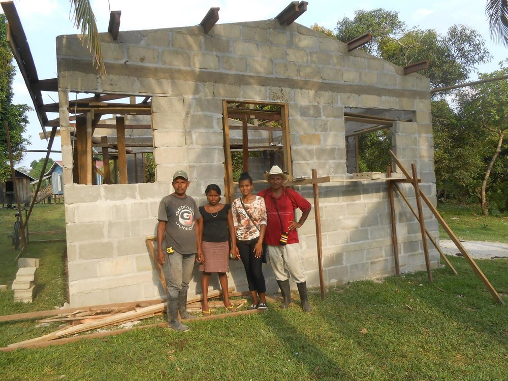 family in front of habitat house.jpg