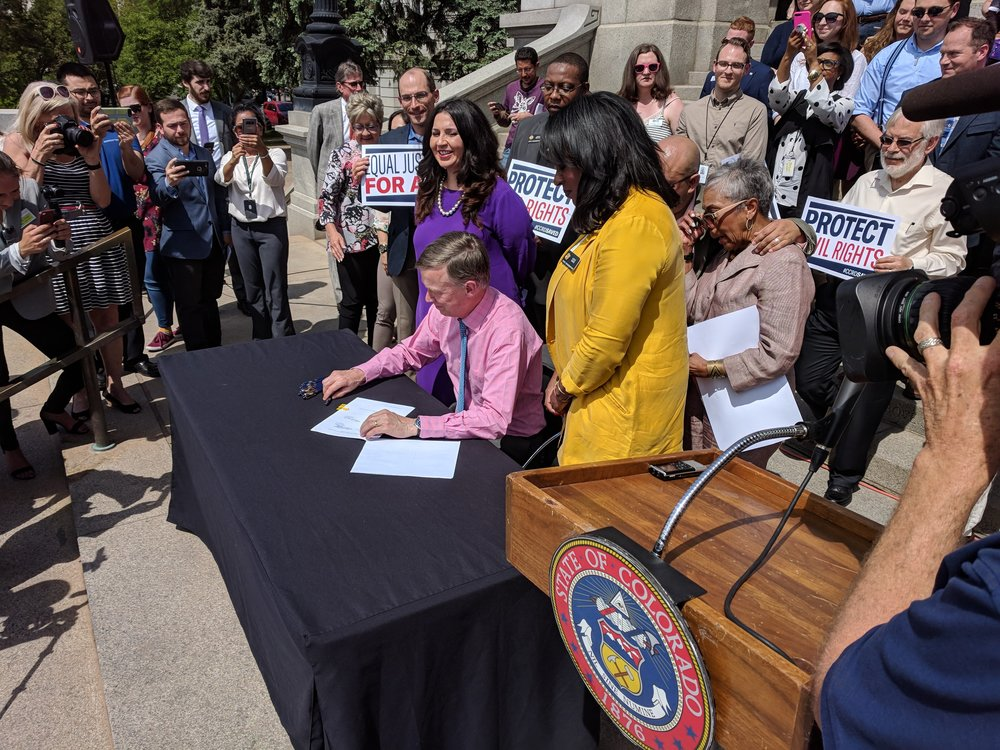 Brianna attended the signing of the Colorado Civil Rights Division (CCRD) which protects the civil rights of citizens of Colorado.